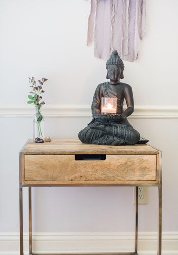 Radiant Heart Wellness Studio table with buddha and flower